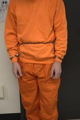 DSC_1962 (bob.laly) Tags: uniform jail shackles handcuffs prisoner jumpsuit inmate