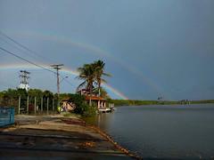 Double Rainbow (Agatha Harumi) Tags: sky beach nature water rain brasil clouds skyscape landscape rainbow bahia doublerainbow