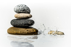it's a balancing act (Morag.) Tags: white color colour water rock stone contrast digital reflections nikon pebble droplet splash nikkor flashgun d3300