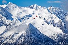 Red Dots (memories-in-motion) Tags: austria tirol zillertal berge alpen schnee mountain snow rot red kugel ball dots drahtseil seilnahn panorama aussicht outlook nature natur hoch high gipfel peak canon eos sky blue blau wolken cloud sigma 7d