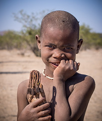 Himba girl with doll (loveexploring) Tags: africa africanchild africangirl himba himbadoll himbagirl kaokoland kuneneregion namibia child doll girl girlwithdoll portrait seminomadictribe tribalgirl tribe younggirl