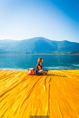 Meditating (Nicola Pezzoli) Tags: travel blue italy mountain lake art tourism nature water colors girl yellow canon reflections design piers floating meditating bergamo brescia lombardia christo iseo