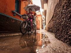 Monsoon Rides - Bengaluru,  India (Kartik Kumar S) Tags: monsoon rains bangalore karnataka india shivajinagar kids children cycle bicycle streets canon photography