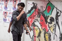 H504_3519 (bandashing) Tags: superimposed 4hands layers art street people flag 1971 warofindependence murial wall paint sylhet manchester england bangladesh bandashing aoa akhtarowaisahmed socialdocumentary manyhands godlike fourhands smoke holdphone