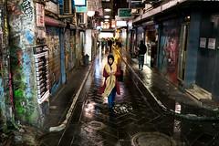 After the rain (Derek Midgley) Tags: dsc04592 lady woman centre place melbourne friday night streetphotography australia rain reflections lane alley street