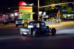 Hot rod truck at night on South Congress.