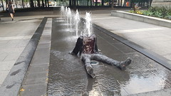 Headless Man in Fountain | Square Victoria, Montreal (Exile on Ontario St) Tags: montral fountain decapitated headless disembodiedhead body montreal fontaine water publicart installation silly surprising eau publique jetwater jet jets waterjet jetdeau jetsdeau squarevictoria quartier international district placevictoria shocking victoriasquare place square victoria urban urbain ville city vieuxmontral oldmontreal summer t person human clothes art public artpublic sitting drenched mouill wet tremp soaked soak vtements linge dcapit sans tte woman passerby dress legs missing drench disembodied corps tronc squirting squirt sprinkler neck cou tranch coupe tt chopped