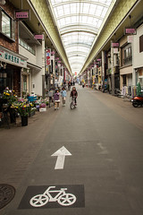 kyoto-2704 (yukkycakes) Tags: kyoto japan shoppingmall shops arrow bike girl flowers florist
