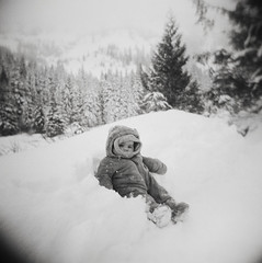 snow baby (manyfires) Tags: trees winter blackandwhite bw baby snow film oregon analog forest holga child hiking mirrorlake toycamera son hike mthood pacificnorthwest pnw snowbank