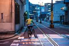 Bicycle (kmmanaka) Tags: japan nagasaki evening harbor tram dejima meganebashi scooter