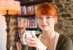 Gorgeous woman holding a cup of tea (Semmick Photo) Tags: beauty cosy cup female girl lady orange person portrait pretty relaxation warm woman beautiful beverage bookshelve casual caucasian coffee comfort comfortable curly day domestic drink happiness happy healthy home homely house indoors lamp leisure light looking one recreation redhair redhaired relaxing rest sitting smiling sweater tea wellbeing white