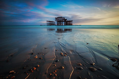 West Pier Sunset (-*HJS*-) Tags: beach beacheslandscapes brighton canon clouds coast colours dusk eastsussex england fullframe sky landscape leefilters lowlight manfrotto ngc ocean pier reflection sea seascapes sunset splash sussex tripod tide water waves 5dmk2 1635mm 2016