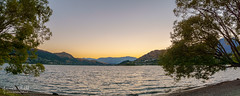 Lake Wakatipu at Dawn (jkuphotos) Tags: travel trees newzealand sky lake mountains water sunrise landscapes scenery glow southisland otago queenstown remarkables clearsky lakewakatipu clearskies theremarkables