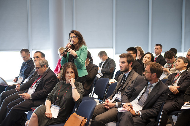 An attendee discussing with the speakers