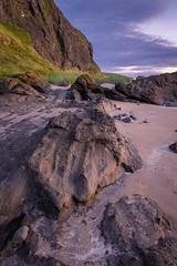 Ayr cliffs rock formation, Ayr, 14th July 2016. (garyal23) Tags: ayr cliff face landscape land scotland rock rocks sky grass sunset fuji xe1 18 55 mm 28 4 lens location hyperfocal calm west coast warm leading lines line