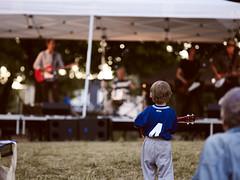 The Guitarist (StephenCaissiePhoto) Tags: park boy summer urban toronto grass musicians evening fan concert child dancing bokeh outdoor hill band guitars tent danforth shallowdof phaseone p30 captureone