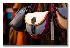 Handbags at dawn (Descended from Ding the Devil) Tags: chianti dof italy raddainchianti sonya7mkii sonyalphadslr tuscany beyondbokeh bokeh depthoffield display fullframe handbags mirrorless photoborder selectivefocus shop