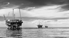 oil drilling rigs at the Santa Barbara Channel (Shot Yield Photography) Tags: oil drilling rigs santabarbarachannel usa california american seascape pollution environment picture shot yield foto photo image photography shotyieldphotography bw black white monochrome