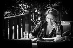 Inspired... (Periades) Tags: bw blackandwhite blackwhite candid ecriture writing fille femme girl human nb noiretblanc photoderue rue streetphotography street streethuman woman