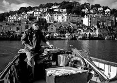 The Ferryman (Uncle Berty) Tags: ferryman ferry man alan looe cornwall east west river harbour crossing small fishing boar sharon black white bnw bw conversion buildings houses holiday properties property favourite photo ever portrait public candid