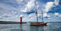 Red Witch (mr_sarcastic1984) Tags: landscapes landscape wisconsin kenosha boat ship ships boats photo photos photography clouds cloudscapes water waterscapes lighthouse reflection reflections red witch