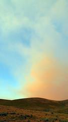 Forest Fire Smoke Coming Over the Hills 1 (Dan Beland) Tags: sunrise cottoncandyclouds yellow blue grey rollinghills foothills hills sagebrush lush morning sky clouds colorful sage bakeridaho salmonidaho tendoyidaho lemhicounty beaverheadmountains rockymountains unitedstates usa northamerica artistic art nature idaho samsunggalaxynote4 outdoor cloud landscape forestfiresmoke smoke coloredsmoke pink peach babyblue