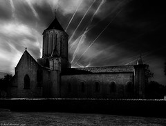The wrath of God. (Neil. Moralee) Tags: franceneilmoralee neilmoralee wrath god church moody dark sinister contrails vapour atmosphere trail air plane aeroplane airport sky clouds black white mono monochrome bw blackandwhite neil moralee nikon d7100 france building architecture lightroom vapor fly bombing war evil good airstrike