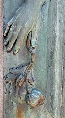 Hand with poppy - detail of a verdigris grave relief (Monceau) Tags: cimetireduprelachaise prelachaise hand poppy verdigris relief sculpture mausoleum door