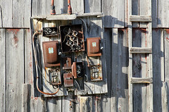 Obstacle Course (Doris Burfind) Tags: electricity wires rust barn farm