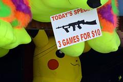 Today's special (jcdriftwood) Tags: today special carnival fair gun machinegun game target stuffedanimal midway pikachu sign pokemon