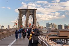 Brooklyn (Bridge) Blues (Torsten Reimer) Tags: helicopter himmel unitedstatesofamerica streetphotography people bridge northamerica nyc newyorkcity musician sky clouds usa skyline wolken brooklynbridge newyork unitedstates us