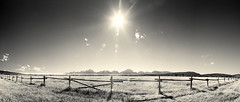 Fenced In (Kevin Rodde Photography) Tags: monotone sun sunset panorama fence greyscale mountains grandtetonnationalpark grandtetons grass grassland wyoming wildwest nationalparks canon 6d 24105mm rodde kevinroddephotography landscape distortion
