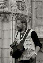 Photographer (Natali Antonovich) Tags: camera brussels portrait monochrome festival photographer belgium belgique belgie lifestyle stare sablon ommegang photographercamera dezavel sweetbrussels magicianfriendcamera