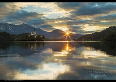Bled (Steve-P2010) Tags: lake church water sunrise reflections dawn peaceful slovenia bled serene ripples starburst intothesun lakebled churchofassumption copyrightsteveprice