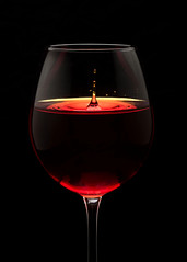 The last drop. (Vinod_Sunder) Tags: glassware wineglass wine splash droplet stemware tabletop