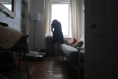 Packing (danieljbec) Tags: edinburgh scotland living room lounge packing light window wood floors ella becker wife home table couch portrait lady girl woman