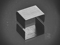 Planet : Cube (mostaphaghaziri) Tags: mm 105 nikkor 7200 d d7200 nikon micro gravity staples cube white black mirror macromondays mondays macro inthemirror