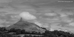 Glastonbury Tor, Somerset (Daryl 1988) Tags: clouds cloud cloudporn scenery view landscape landscapephotography photography hill famous landmark building history historical somerset glastonbury tor glastonburytor natural blackandwhite black white tower stmichealstower summer countryside country naturalbeauty touristattraction uk nikon d2xs england britain trees