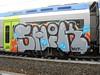 033 (en-ri) Tags: schick pevs crew mf toa lacasitos grigio nero giallo arancione azzurro train torino graffiti writing