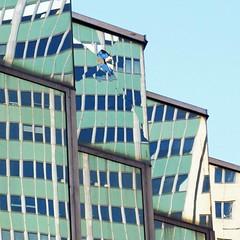 breaking the facade (weltreisender2000) Tags: green glass facade blue windows modern office building broken reflection montreal