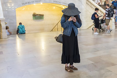 Reclusive (wwward0) Tags: cc grandcentralterminal hat indoor manhattan midtown nyc standing trainstation woman wwward0 newyork unitedstates us