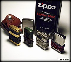 Zippo lighters and knot work (Stormdrane) Tags: stormdrane zippo lighter brass stainless steel camo spark flame fire burn light cigar pipe cigarette torch pouch leather fuel naptha edc everydaycarry decorative useful beprepared survival camping hiking backpacking fishing boating sailing zombie apocalypse geocache bushcraft flint belt snap gift turkshead gaucho spanish ring pineapple weave tie braid grip secure texture design