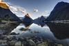 The Sound at sunrise (bgspix) Tags: blue newzealand sun mountain lake reflection beach rock sunrise landscape photography mirror reflect shore nz sound fjord milford bluehour mitre mitrepeak canoneos5dmarkiii ef1635mmf4lisusm