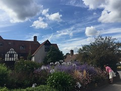 Clouds and flowers at Wisley. (Englepip) Tags: wisley rhs garden flowers house visit sky clouds colour plants architecture park public person pink blue purple white roofs iphone