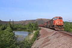 Two 741/'s (GLC 392) Tags: railroad tree cars water mi cn train iron michigan railway canadian junction hills national empire ore mounds piles jennies emd jct tailing neguanee 5779 5741 sd75i u741