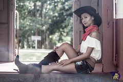 Cowgirl III-4 (Chindit76) Tags: boss sexy travelling girl hat train asian thailand model sitting boots outdoor longhair railway skirt jeans western desaturated filipina cowgirl steamengine stetson steamtrain pattaya freighttrain neckerchief watermarked