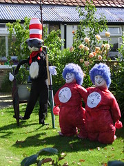 The Cat In The Hat scarecrows (Nekoglyph) Tags: hinderwell scarecrow festival 2016 yorkshire thecatinthehat drseuss thing1 thing2 blue red striped hat black white garden sunny characters childrens book flowers umbrella furry grass
