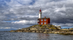 Fisgard Lighthouse (Paul Rioux) Tags: britishcolumbia vancouverisland victoria westshore colwood fisgard lighthouse fortroddhill nationalhistoricpark clouds storm rocks waterfront water reflection outdoor scenic morning prioux