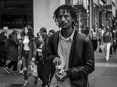 Trail Mix (Leanne Boulton) Tags: people monochrome urban street candid portrait portraiture streetphotography candidstreetphotography candidportrait eyecontact candideyecontact man male face facial expression look emotion feeling streetlife eyes stare glare unhappy confrontation snack tone texture detail depthoffield natural outdoor light shade shadow city scene human life living humanity society culture character canon 7d 50mm black white blackwhite bw mono blackandwhite glasgow scotland uk