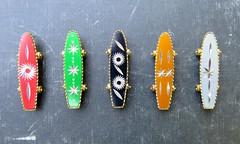 skateboard charms (Black Cat Bazaar) Tags: vintage skateboard charm necklace aluminum colored carved metal blackcatbazaar etsy starburst